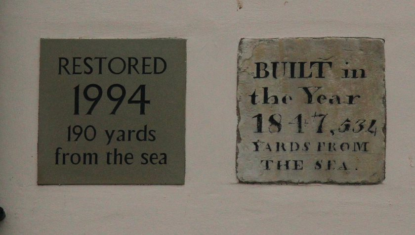 Plaques on the side of the Blue Bell, Kilnsea. They illustrate the destructive power of the North Sea. Destructive seas appear in Tolkien's work at the end of the First Age, and the Downfall of Numenor in the Second Age.