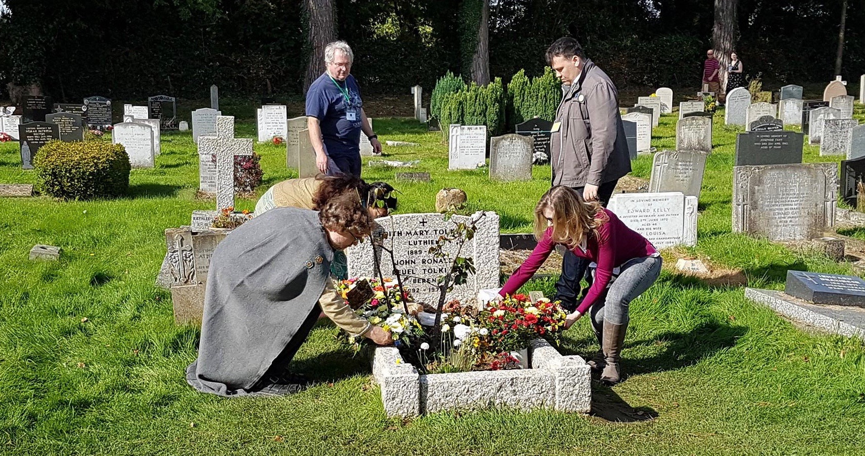 Representatives of visiting Tolkien Societies laying wreaths on Tolkien's grave at Wolvercote Cemetery, Oxford
